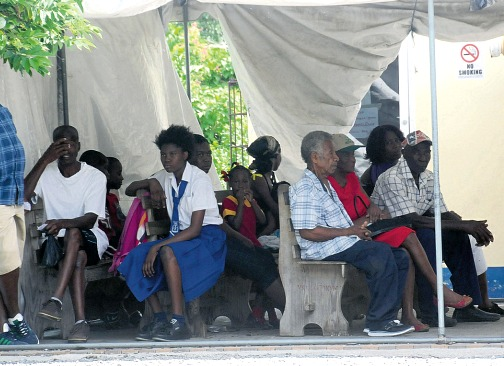 People wait to see the doctor at Yallahs Health Centre.