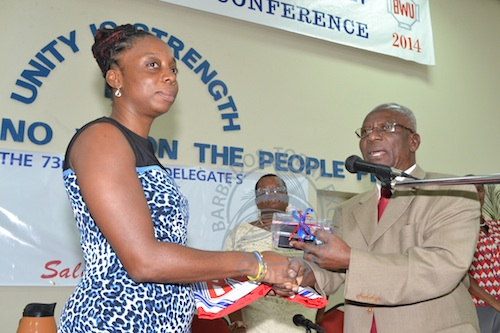 Toni Moore receives the symbols of the BWU from Sir Roy Trotman.