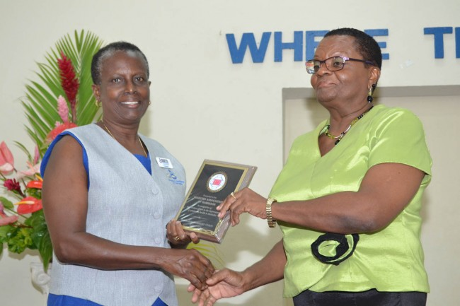 President of the Diabetes Association Noreen Merritt receives a plaque for the work being done by association.