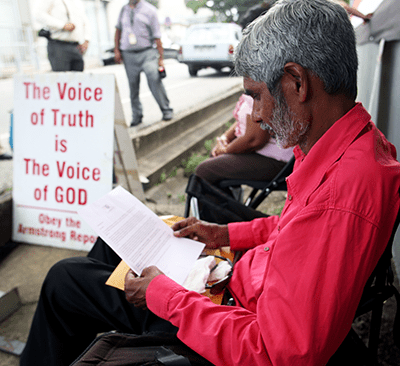 Highway Re-route Movement leader Dr Wayne Kublalsingh reads the letter sent to him by Prime Minister Kamla Persad-Bissessar on the second day of his hunger strike outside the Office of the Prime Minister, St Clair, Port-of-Spain, yesterday.