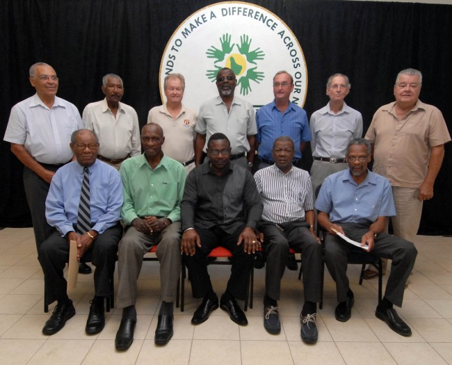 Present at today's function were (seated from left) Sir Everton Weekes, Sir Wes Hall, Minister of Social Care Steve Blackett, Seymour Nurse and David Holford. Standing (left to right) are Peter Lashley, Rawle Brancker, David Allan, Charlie Griffith, Robin Bynoe, Tony Cozier and Arthur Bethell.