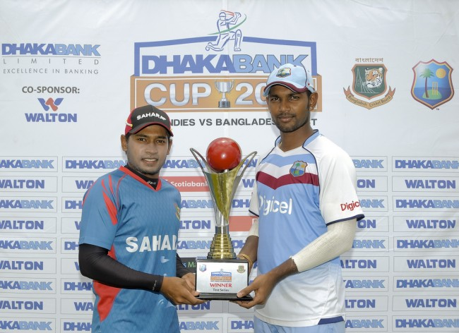 West Indies captain Denesh Ramdin (right) and Bangladesh skipper Mushfiqur Rahim posing with the trophy for which their teams will be competing in the Test series.