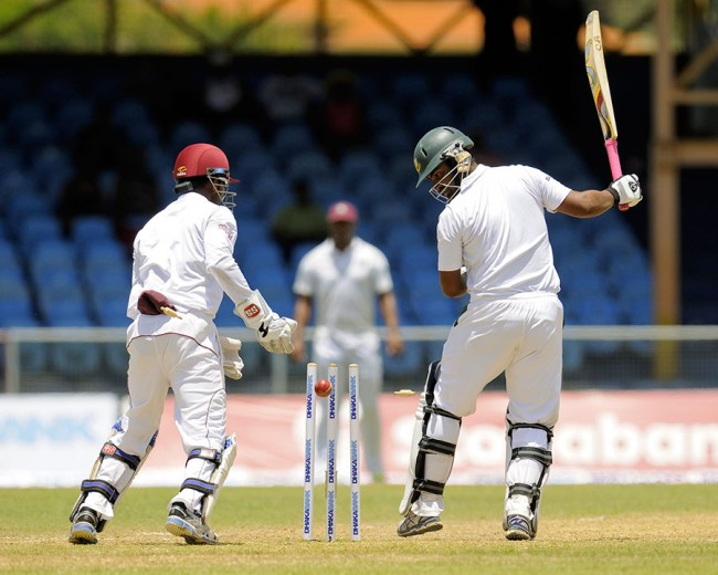 Opener Tamim Iqbal is bowled by Sulieman Benn shortly after passing his half-century.