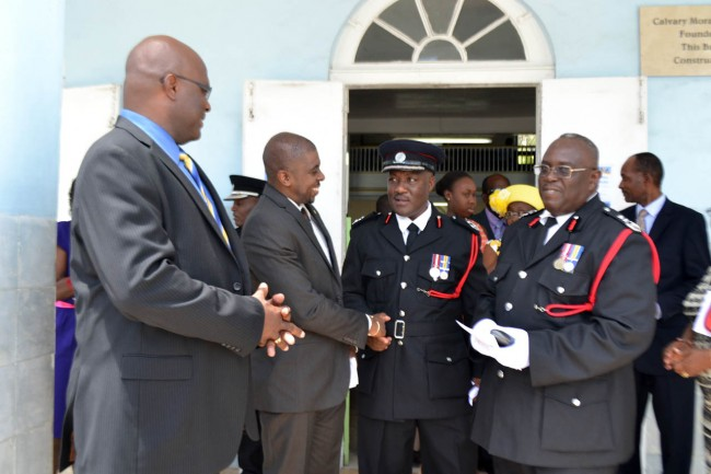 A light moment among (from left) Attorney General Adriel Brathwaite, Reverend Adrian Smith of Calvary Moravian Church, Deputy Chief Fire Officer Errol Maynard and Chief Fire Officer Wilfred Marshall.