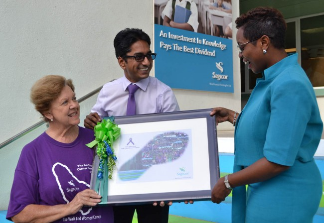 President of the Barbados Cancer Society Dr Dorothy Cooke-Johnson (left) and team captain of Globeathon Barbados, Dr Vikash Chatrani (centre) presenting a token of appreciation to Sagicor's assistant vice president, Marketing, Tracey Knight-Lloyd.