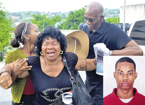 Evadne Hamilton (left), aunt of Mario Deane (right), weeping uncontrollably as her nephew's body is whisked from the Cornwall Regional Hospital morgue by a hearse from Madden's Funeral Home.