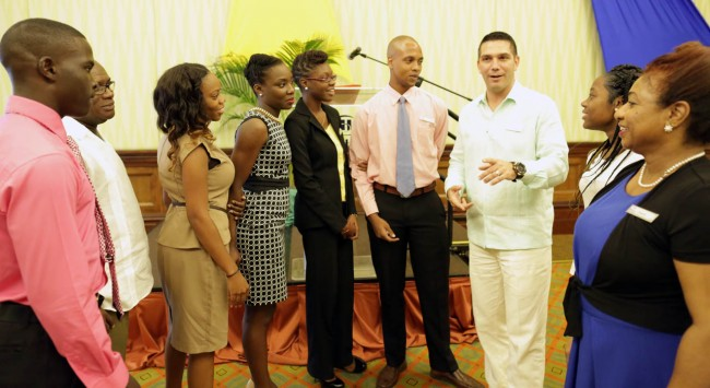 Hilton Barbados Resort's general manager George Stanfield (third from right) in discussion with some of the scholarship applicants as Needham's Point Holdings Ltd chairman Kenneth Gittens (second from left) and Hilton's director of human resources Cheryl Corbin (right) look on.