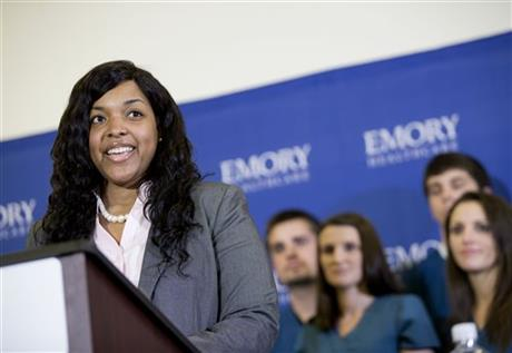 Amber Vinson, 29, the Dallas nurse who was being treated for Ebola, speaks at a news conference as members of her nursing staff look on after being discharged from Emory University Hospital today.