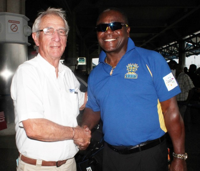 Barbados Tridents' coach Desmond Haynes (right) greeted at the airport today by Sir Charles Williams.