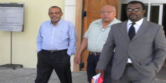 From left, fraud accused Rodney Wilkinson, accompanied by businessman Lionel Riley and attorney Marlon Gordon, leaving court earlier today.