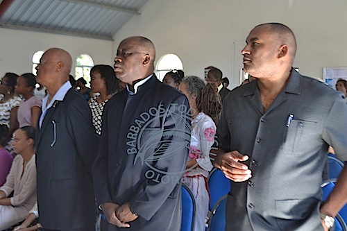MPs Richard Sealy (right) and James Paul were among officials attending the service.