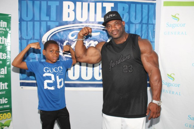 (From left) Former primary school bodybuilder Kezza Goodman Hinds posing with Dexter Jackson today.