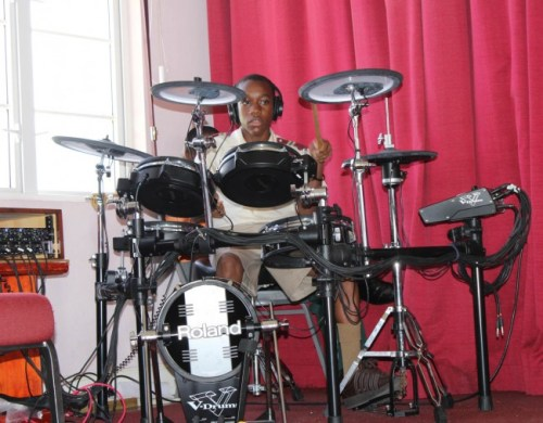 Jeuel Franklyn playing the drums during the service.