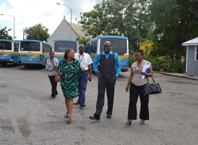 Minister of Transport Michael Lashley (centre) with corporate communications specialist at Transport Board Lynda Holder (left) and acting permanent secretary in the Ministry of Transport Donna Cadogan.