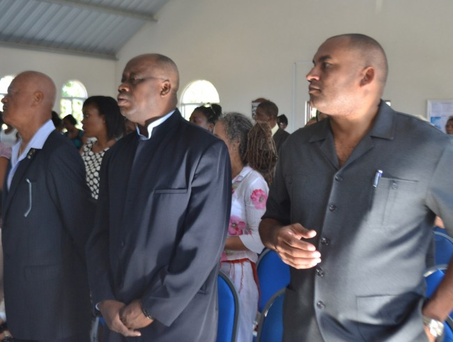 Minister of Tourism Richard Sealy (right) and Member of Parliament James Paul (centre) were among those attending the service.