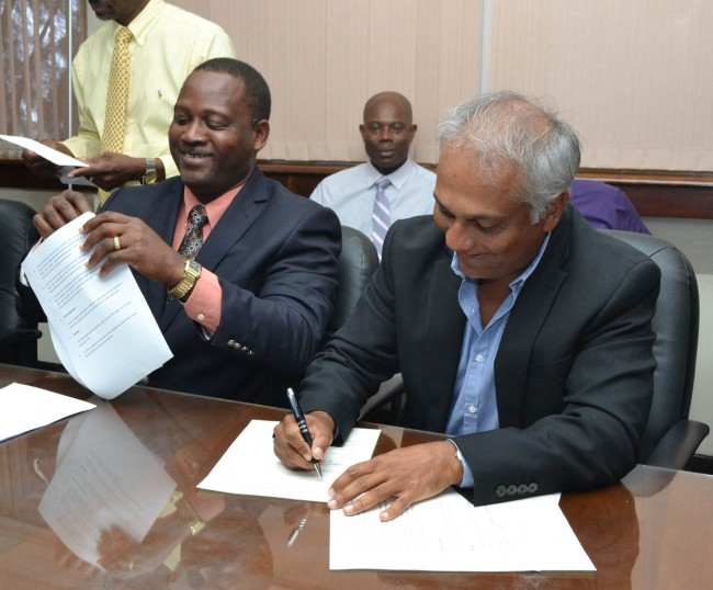 SIGNED AND SEALED It has not come without controversy, but Government can now rest a little easier having reached agreement with local hoteliers who have been clamouring for the same level of concessions recently offered to Sandals hotel.  Here, Minister of Industry Donville Inniss (left) and BHTA president Sunil Chatrani were all smiles   during today's signing of their MOU. (Picture by Rollin Williams.)