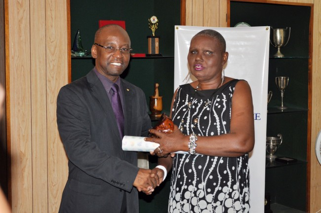 The Chairperson of Christ Church Community group receives her token.