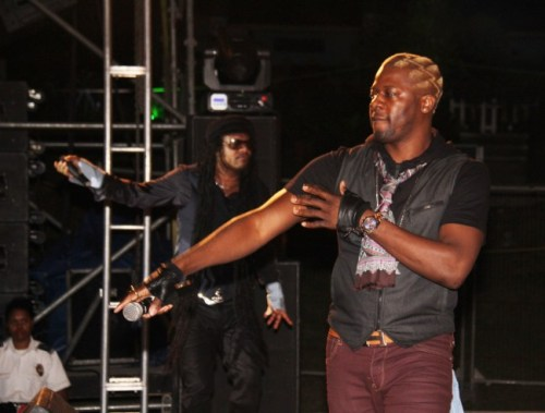 Dennis The Menace and Maxi Priest in the background during their dancehall session.