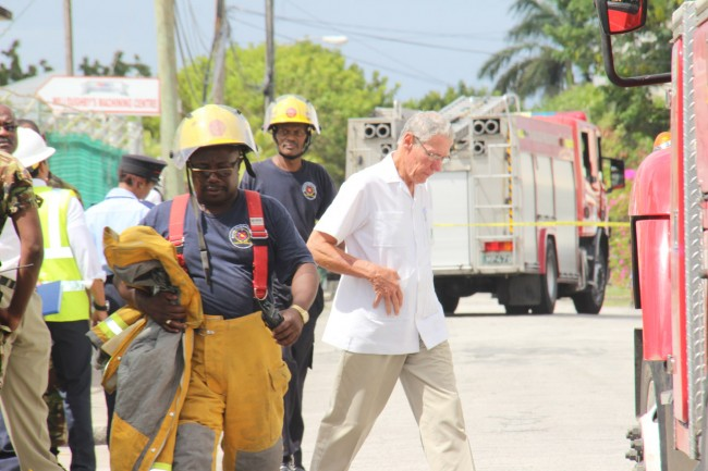 Chairman of Williams Industries, Ralph Bizzy Williams, makes his way to the scene of the tragedy.