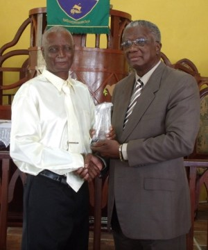 Ernest Forde receives his award from the Prime Minister.