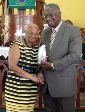 Norma Frank receives her award from the Prime Minister.