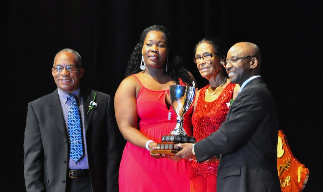 Irecka Louis (second left) and Kathy Harper-Hall accepting the National Sports Personality Award from Minister of Sports Stephen Lashley. NSC chairman Michael Power looks on.