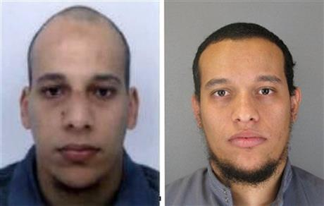 This photo provided by The Paris Police Prefecture Thursday, Jan.8, 2015 shows the suspects Cherif, left, and Said Kouachi in the newspaper attack along with a plea for witnesses.