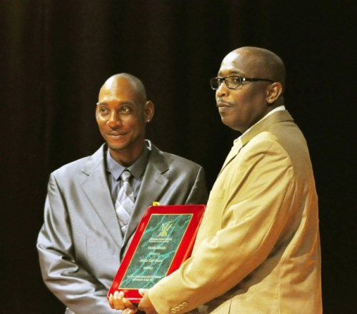 Winston Brathwaite (right) of Emtage Electrical presenting coach of the Davis Cup team, Kevin Yarde with the Team Award.