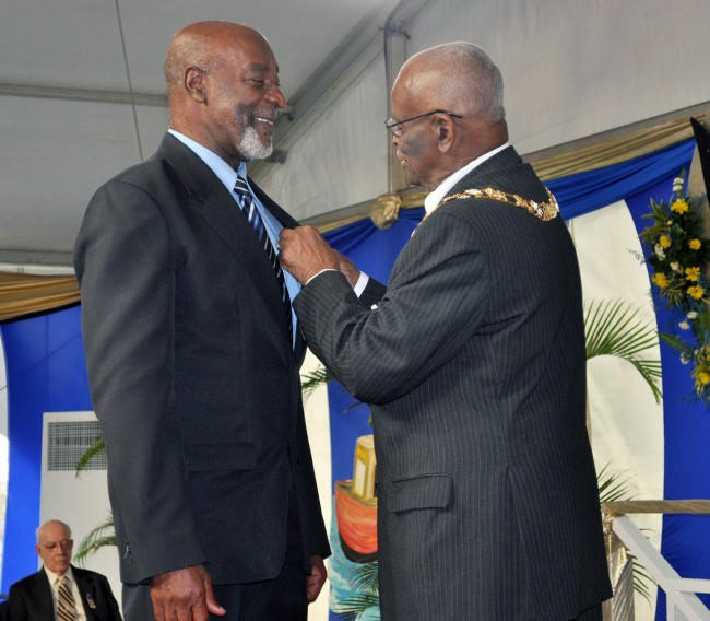 Governor General, Sir Elliott Belgrave, seems to have a lot to talk about with veteran trade unionist, Dennis Clarke.