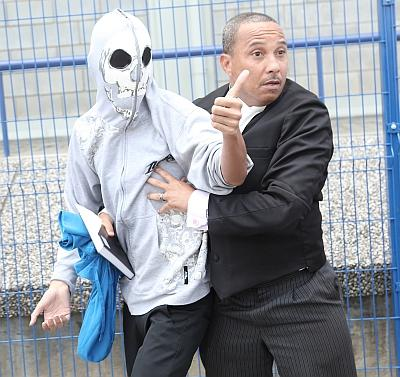 Attorney Larry Williams restraining 22-year-old Matthew Soo-Chan as they left the Tunapuna Magistrates' Court yesterday.