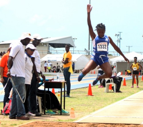 Akayla Morris of The Lodge School jumped high and landed long enough to defeat all- comers in the under-15 girls long jump.