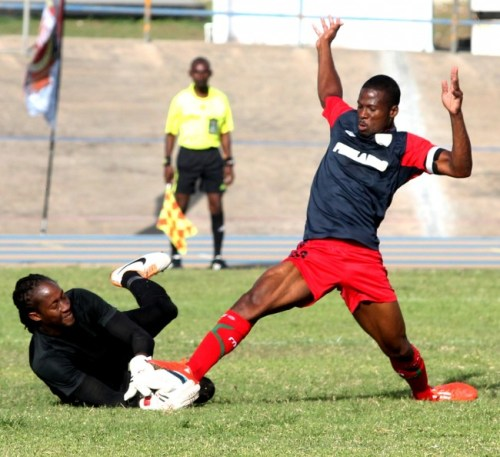 Arantees Lawrence scored two goals for his side including this one when he managed to get the ball out of the hands of Paradise goalkeeper Jason Boxill.