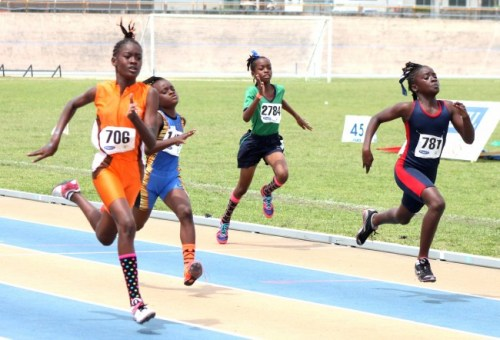 Azariah Nurse of Bayley's Primary (left) was too good for the competition in the under-11 girls 100m.