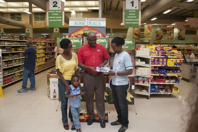 Managing director of Carlton and A1 and Emerald City Supermarkets Andrew Bynoe (centre) hands over the grocery vouchers to second place winner Neil Marshall (right) and third place winner Kim Ashby (left).