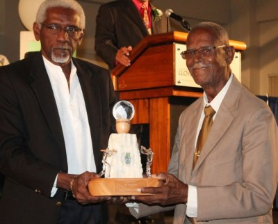 Ellerslie's long-serving coach Irvin Harris (right) receiving his award from BCA board member, Conde Riley.