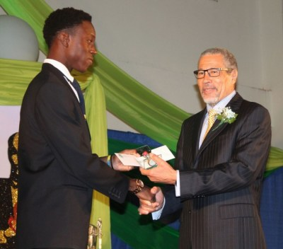Emerging cricketer of the year, Chad Williams from Guardian General Barbados Youth, received his prize from David Deane.