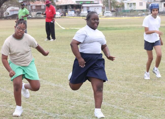 Justina Pollard of Sunshine Early Stimulation Center won the girls 5-7 25m.