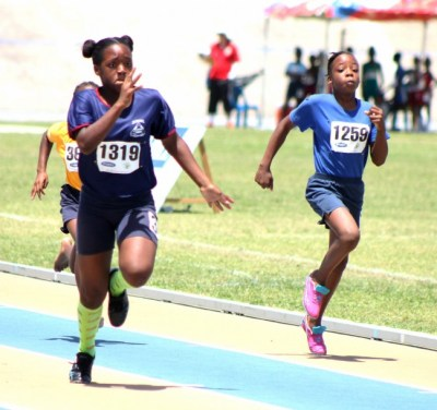 Kiara Payne (left) of St Stephen's Primary won her heat of the under-13 girls 100m.