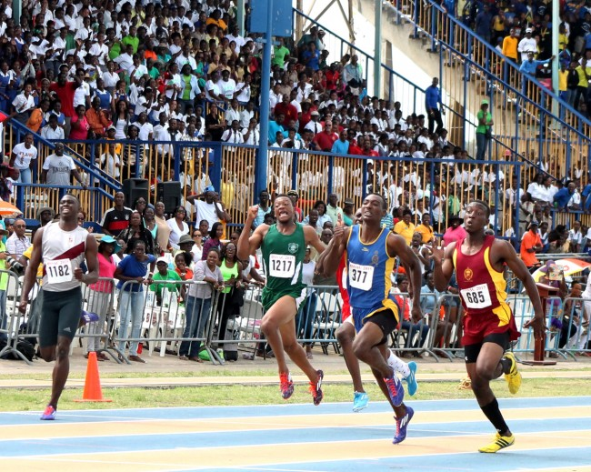 Mario Burke of Harrison College (right) won the under-20 boys 200m ahead of Combermere's Ramarco Thompson (second right).