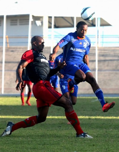 Paradise striker Armando Lashley (right) scored for his team who came from behind to defeat Pinelands 3-2.