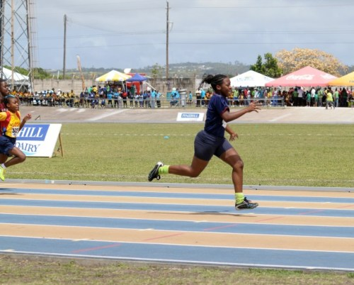 Zaria Knight crusing to victory in her heat of the Under-13 girls 100 metres.