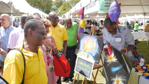 Minister of Housing Denis Kellman looking on at one of the craft stalls.