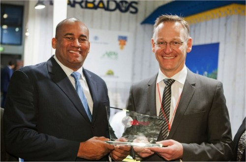 Minister of Tourism and International Transport Richard Sealy receiving the 'Sustainable Destination Promotion on the German Market Award' from Michael Schober, Director Marketing and Travel Procurement at DERPART Reisevertrieb GmbH.