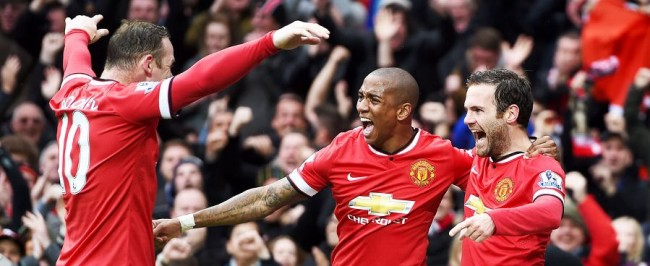 Manchester United's Wayne Rooney (left), Ashley Young and Juan Mata celebrating one of their team's four goals.