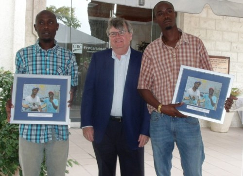 FirstCaribbean CEO Rik Parkhill flanked by mural tilers Dwayne Goddard (left) and Troy Young.