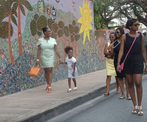 These ladies took a walk past the mural.