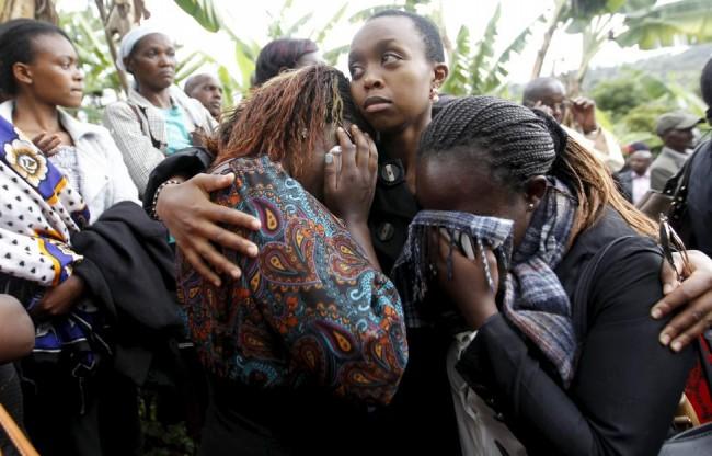 Schoolmates mourn during the burial of Nyokabi, a student killed during an attack by gunmen at Garissa University, in Wanugu village, Gatundu near Kenya's capital Nairobi