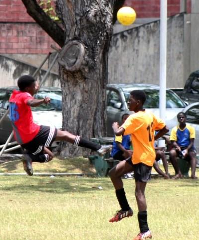 BSA Super Stars goal-scorer Natari Worrell (left) clears the ball away from a BSA Warriors defender.