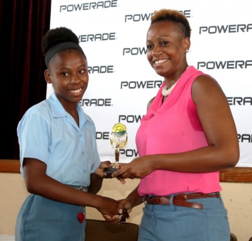 CARIFTA gold medallist Mary Fraser (left) received several trophies during the BSSAC awards ceremony and among them was for the girls' 3000m record.