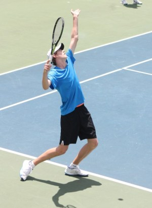 Canadian Joshua Peck served his way to victory over Puerto Rican Sebastian Arcila in 18 and under singles action.